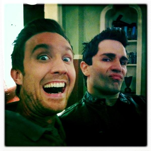 Sam Huntington & Sam Witwer making faces on set