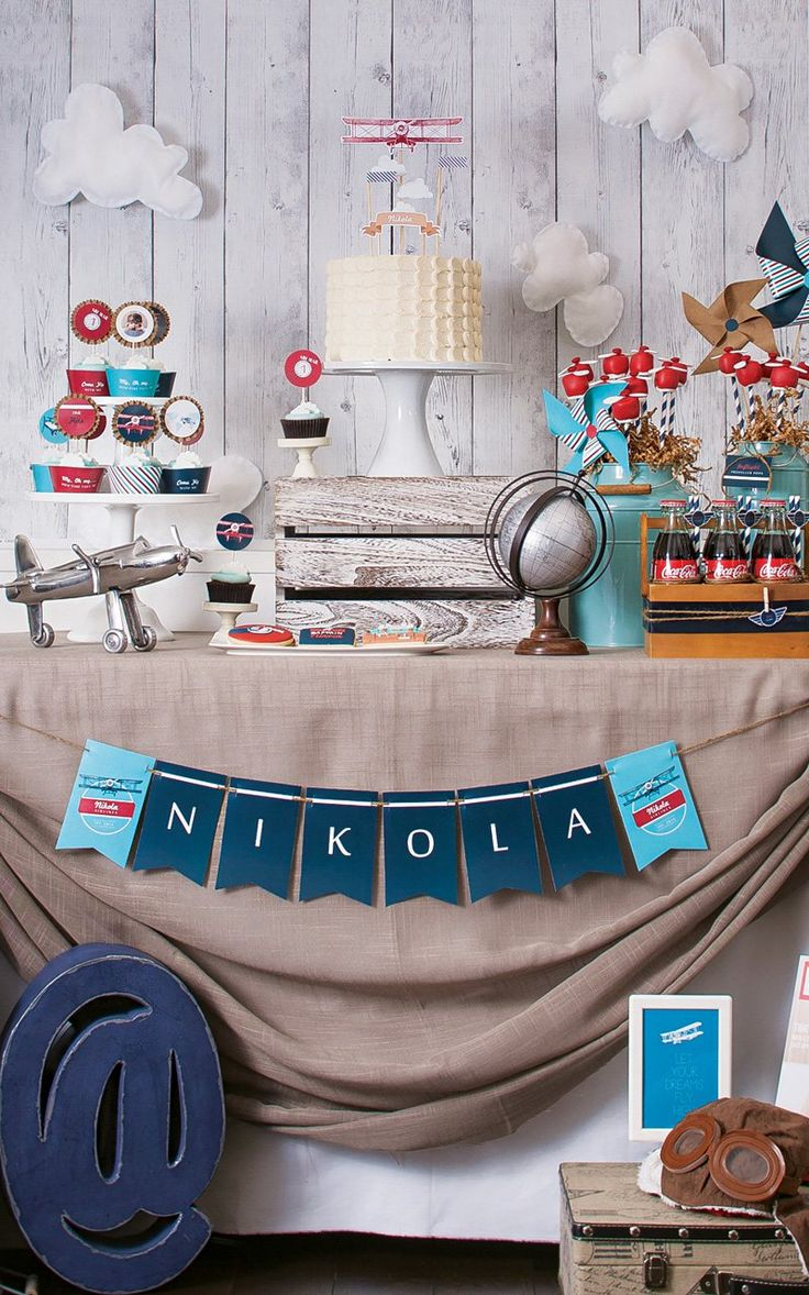 Time Flies! This Airplane First Birthday has retro decor, propeller marshmallow pops, in-flight beverage cart, plane ticket invitation, cloud cupcakes & more..