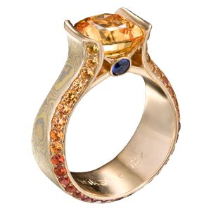 the little spark of blue & the side graduating stones make this ring for me!