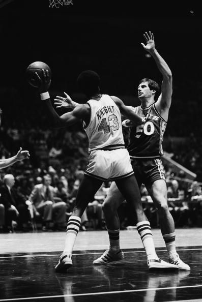 NEW YORK � MARCH 18: Toby Knight #43 of the New York Knicks gets ready to make a pass while Steve Mix #50 of the Philadelphia 76ers defends during a game on March 18, 1978 in New York, New York.