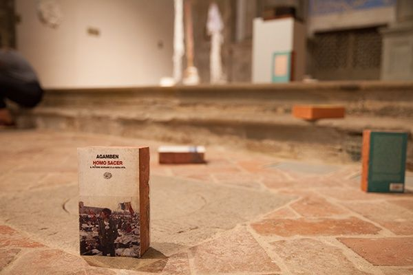 "Claire Fontaine, 'Homo Sacer brickbat', 2007,brick and brick fragments, archival digital print and optional elastic band, 191 x 115 x 55 mm at ICASTICA 2015, ""Cultivating Culture in Arezzo"", 28 giugno - 27 settembre 2015"