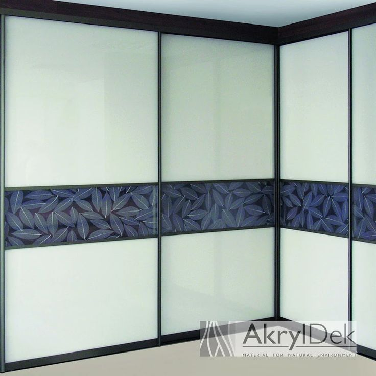 Built-in wardrobe with sliding system, filling of resin panel with design of white leaves for home decoration.