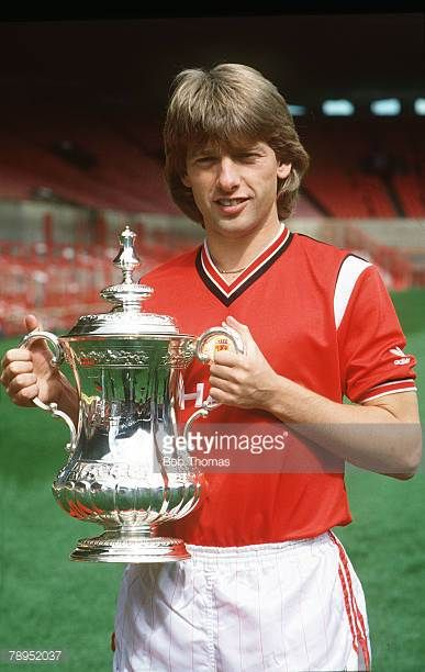 1985 Manchester United's Danish international Jesper Olsen holds the FACup won by United in the 1985 Final as they beat Everton 10