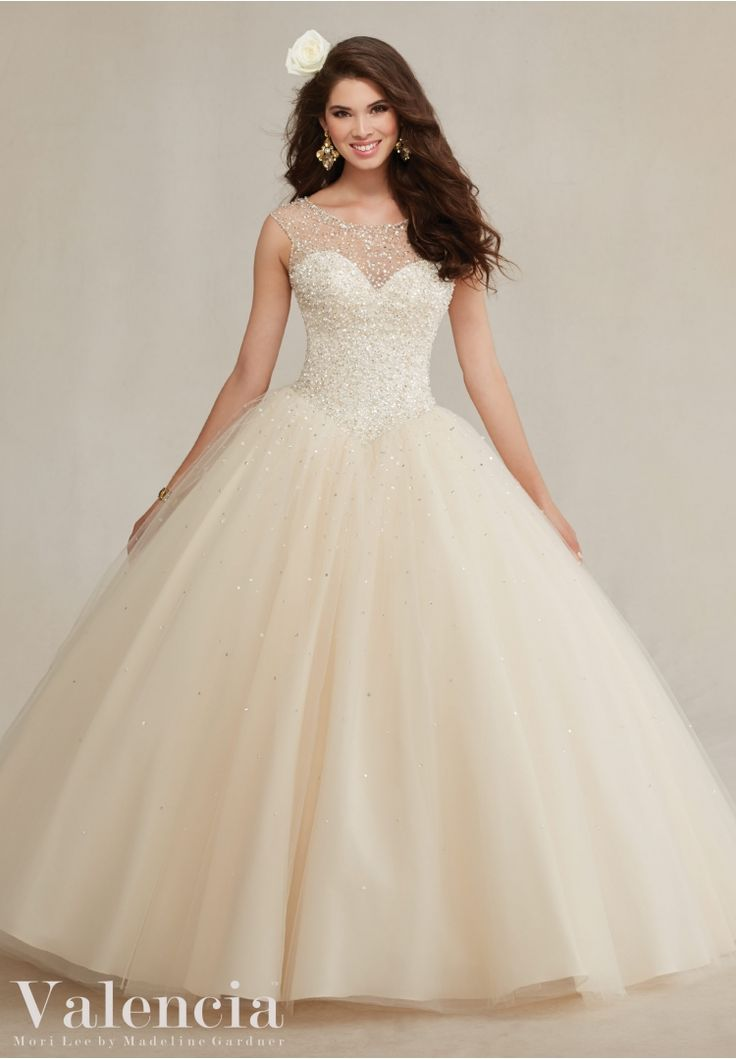 Quinceanera dresses by Vizcaya Beaded Tulle Ball Gown Matching Stole included. Colors: Mint Leaf, Champagne, Navy, White.