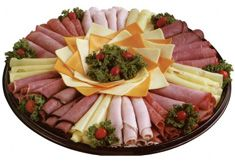 meat and cheese platter - quick and easy. get to the store buy a variety of cold meat n cheese, roll it up. SERVE!