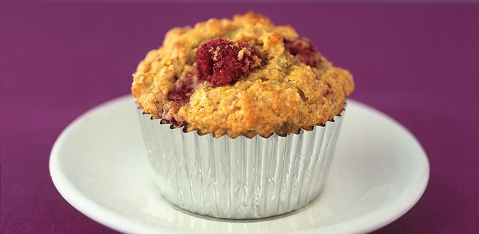 1/2 cup(s) oats, rolled 1 cup(s) milk, lowfat (1%) or plain soy milk (soya milk) 3/4 cup(s) flour, all-purpose 1/2 cup(s) cornmeal preferably stone-ground 1/4 cup(s) wheat bran 1 tablespoon baking powder 1/4 teaspoon salt 1/2 cup(s) honey, dark 3 1/2 tablespoon canola oil 2 teaspoon lime zest grated 1 large egg(s) lightly beaten 2/3 cup(s) raspberries Instructions  Serves 12  Preheat the oven to 400 F. Line a 12-cup muffin pan with paper or foil liners. In a large microwave-safe bowl…