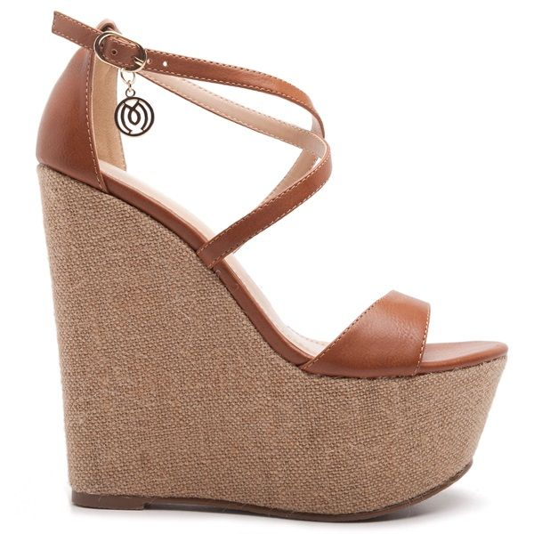 High heel platforms in tobacco colour with cross over straps and small dangling decorative 'M' logo.