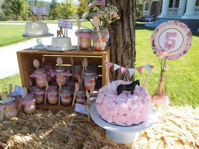 Vintage cowgirl theme. Use hay bales and wodden crates to serve food.