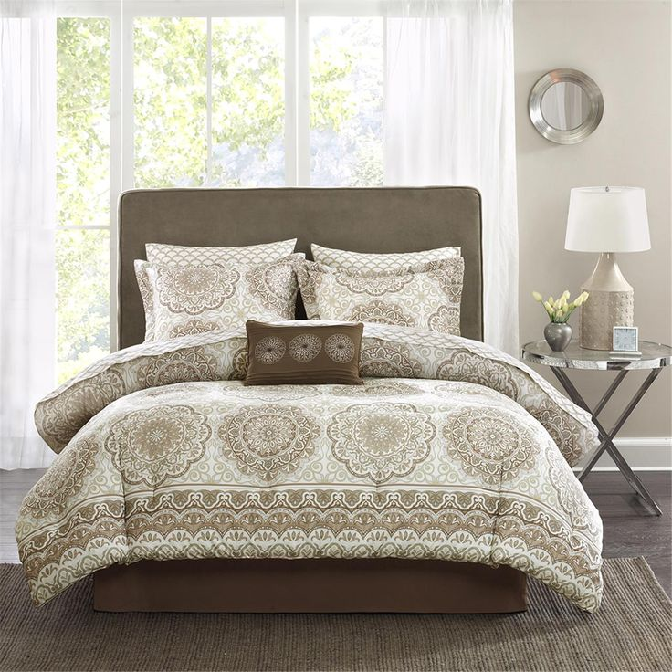 The Madison Park Essentials Coronado Collection instantly adds neutral color to your bedroom. Its soft ivory and taupe floral print with large medallions is a modern twist to a classic look. The embroidered detailing on the decorative pillow pulls the whole look together. This comforter set also includes two matching standard shams, 180 thread count cotton printed sheet set and a solid bedskirt.