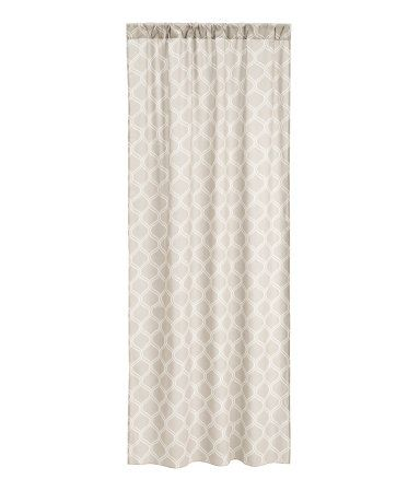Light taupe. Two curtain panels in woven cotton fabric with a printed pattern. Wide cased heading. Hemming tape included.
