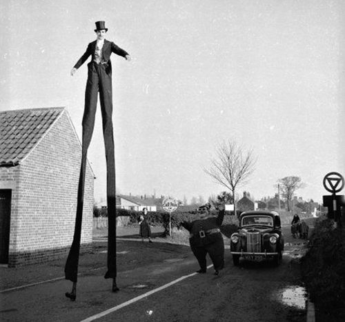 Stilt walker and clown Barry Sloane,  London, 1955