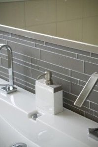 Good idea to tile between mirror and sink (don't like this tile but great idea)