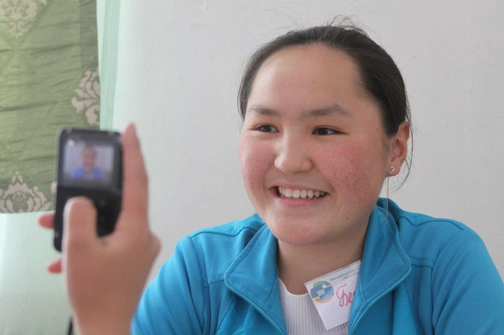 "Begimai Abakirova at Internews' seminar ""Youth Ideas in New and Traditional Media"" in Shabdan, Kyrgyzstan experiment with flip cameras to record their own videos."