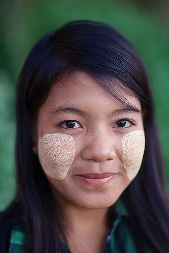 Young Burmese girl with Thanaka paste on her face, Bagan, Burma