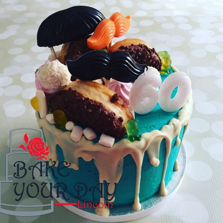 Coconut Drip Cake With chocolate Moustaches , meringues, marshmallows, donuts & gummy bears. enquiries@bake-your-day.co.uk