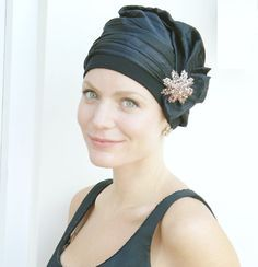 Elegant evening womens cocktail hat that completely covers the head, low onto the nape of the neck. The style is called Ava and designed by