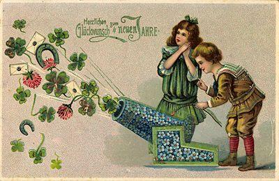 Neujahrswünsche. Alte Postkarte mit Glückssymbolen