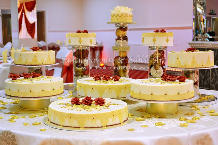 White chocolate, Red & Gold Asian/ Indian wedding cake table display | Fancy Favours & Edible Art -- #wedding #cake #Asian #Indian #indianwedding #asianwedding #gold #marsala #red #white #table #desserttable #tabledisplay #lace #jewelry #beaded #jewellery  #piping #elegant #floral #flowers #rose #petals #henna #sugarart #sugarflowers #ornate #fancy #ffeabysawsen #chocolate #whitechocolate  #handmade #custom #customcake #weddingcake #styled #weddingstyle