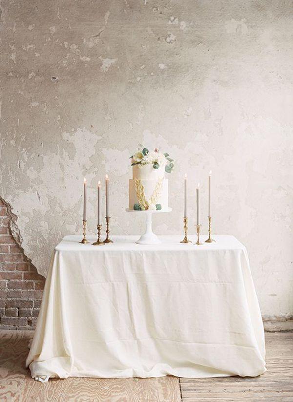 Elegant Neutral Wedding Cake Table with Taper Candles | Morgan Gosch Photography | http://heyweddinglady.com/dreamy-blue-latte-wedding-palette/