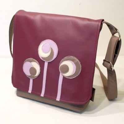 Interesting spacious shoulder strap bag.