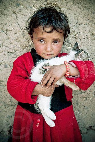 Tajikistan: Portrait of Child with Kitten by Galibert Olivier, via Flickr