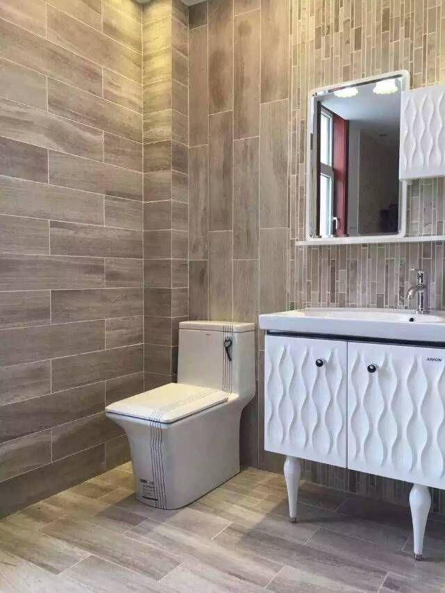 serpeggiante dark gray marble tiles, bathroom wall