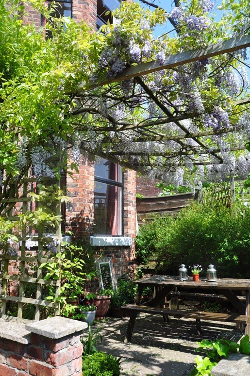I always loved these garden patios all surrounded by trees and flowers