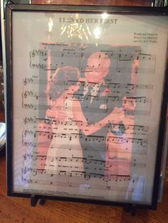 Father's Day gift. Sheet music from our Father Daughter Dance and a picture of our first dance in a picture frame. *I printed the sheet music onto a piece of transparent paper and then placed the picture behind it. I also used a floating glass frame.