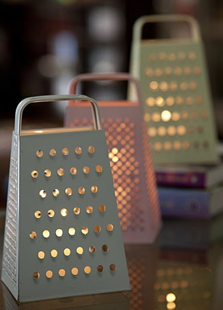 Painted cheese grater as lantern.