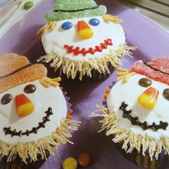 Scarecrow Cupcakes--Easy scarecrow faces using decorator gel, gum drops, chow mien noodles, shredded wheat cereal, m&m's and candy corn. -