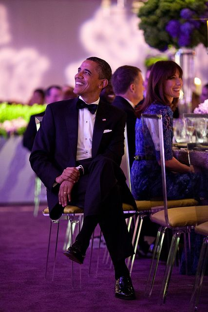 President Barack Obama listens as Prime Minister David Cameron of the United Kingdom offers a toast during the State Dinner on the South Lawn of the White House, March 14, 2012. Samantha Cameron is seated at right. (Official White House Photo by Pete Souza)