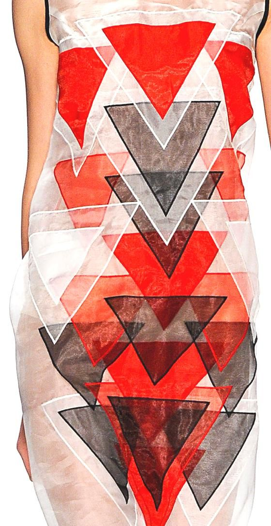 The dress from Vivienne Tam S/S 2013 uses a diverse range of sheer fabrics that has been seamlessly appliquéd overlapping one another to create a variety of different hues and tones that cover the dress. I love the way each harsh geometric piece has been intergrated together to form a colourful abstract design.