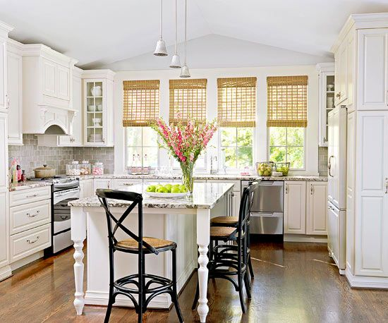 I love this light-filled, practical kitchen! The wall of windows is a stunning effect. And I love the detail of the large molding around each window.