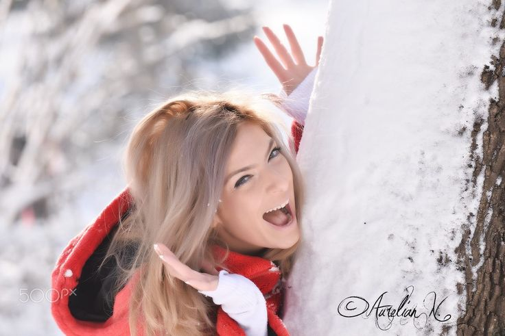 "Happy in the park - Blonde girl that looks happy near a tree with snow!  Folow me on : <a href=""www.facebook.com/naurelianphoto"">Facebook</a> 