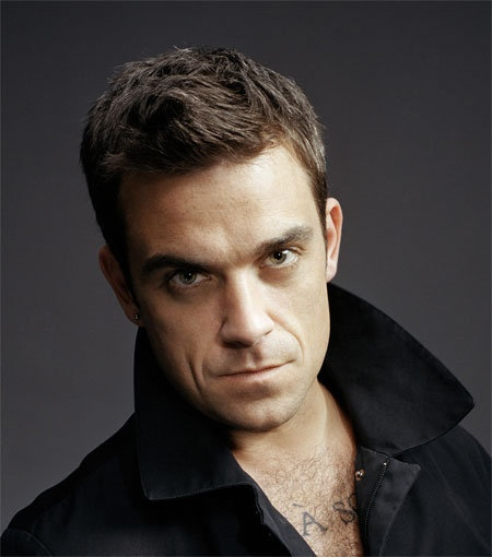 Robbie Williams, a little bit of rough lol. Seen him live and he is AMAZING!!