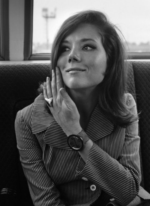Diana Rigg as Emma Peel, from the 1960's show 'The Avengers'.  Her character is an amazing role model - feminine, yet kickass; sexy, yet modest; mysterious and beautiful.  She made being a spy look pretty darn good.
