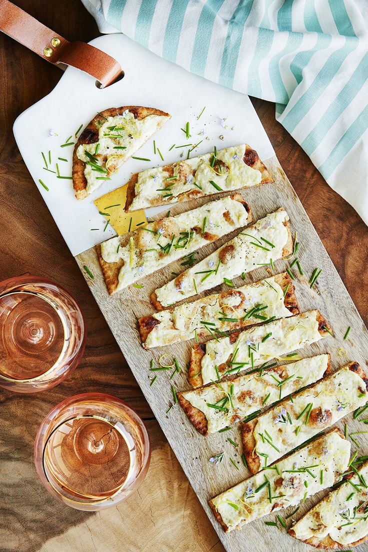 Ricotta Olive Oil Flatbread is a simple, but crowd pleasing hit for your next gathering.