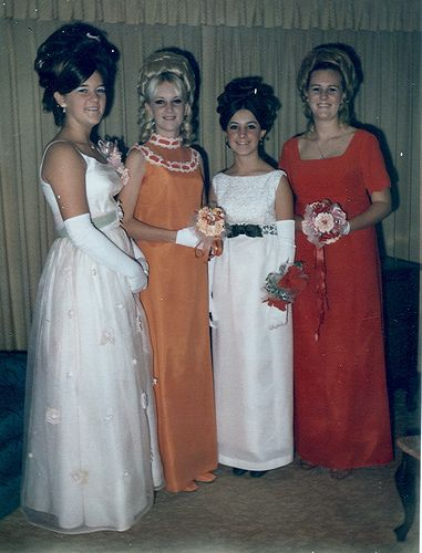 Prom, 1969. My mum has an ALMOST IDENTICAL pic of herself from this era, with the same amazing, ornate hair, wearing her candy-pink chiffon Marie Antoinette-style evening dress that looks a bit like the lady's on far right, but it has lace cap sleeves, and lace and crystals (my mum was annoyed I called them 'sequins' in the book) decorating the bodice.