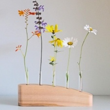 5 STEM FLOWER VASE IN ASH - A simple stylish flower stem vase hand crafted in Ash. This contemporary vase is a great way to have an exuberant display of flowers using only a few stems. I make each vase from an individual piece of wood, hand finished with natural oils to protect it and bring out the natural markings in the timber. A completely unique gift for a wedding, birthday or Christmas, or just a personal indulgence! £55.00