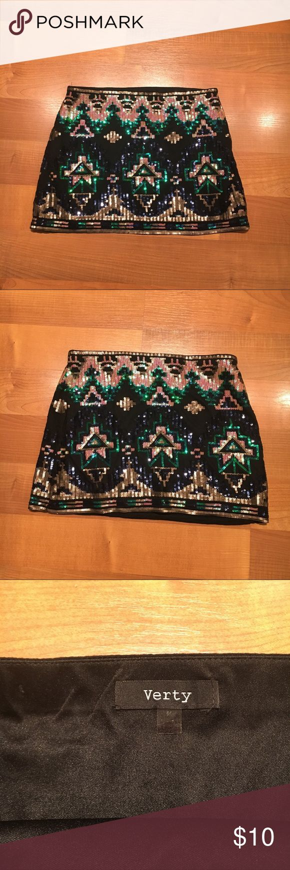 🎉 New Years Verty Aztec Sequin Skirt in Black Cute Aztec mini skirt that has sequins on both sides of the skirt. Perfect for New Years! Size medium but material is stretchy. Can fit size small as well. The stitching has come undone in one place along the inside top of the skirt. Can be trimmed away and does not affect wearability. This is a perfect skirt for a night out. Smoke free home. Bundle to save 30%. verty Skirts Mini