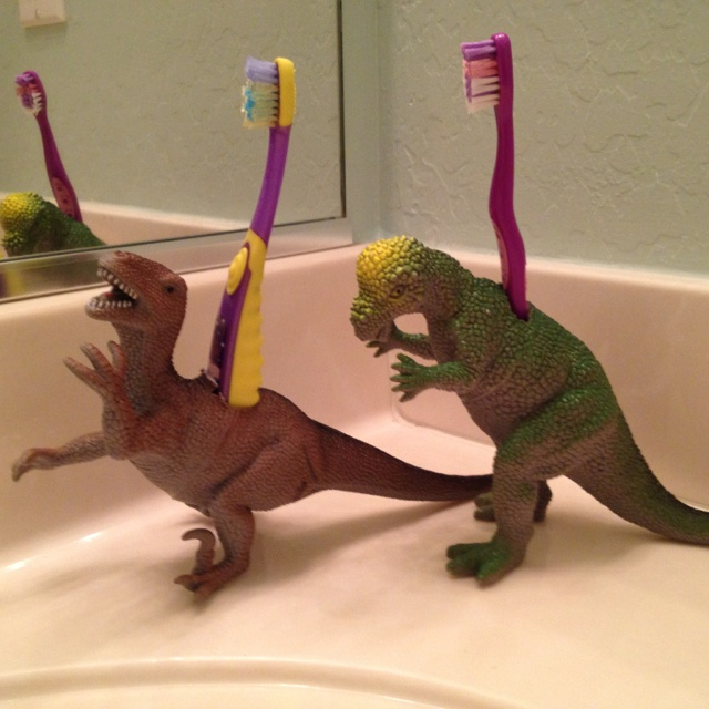 Just Cut Holes Big Enough To Fit Toothbrushes In Hollow Plastic Dinosaurs  To Create Fun Toothbrush Holders For Kids!