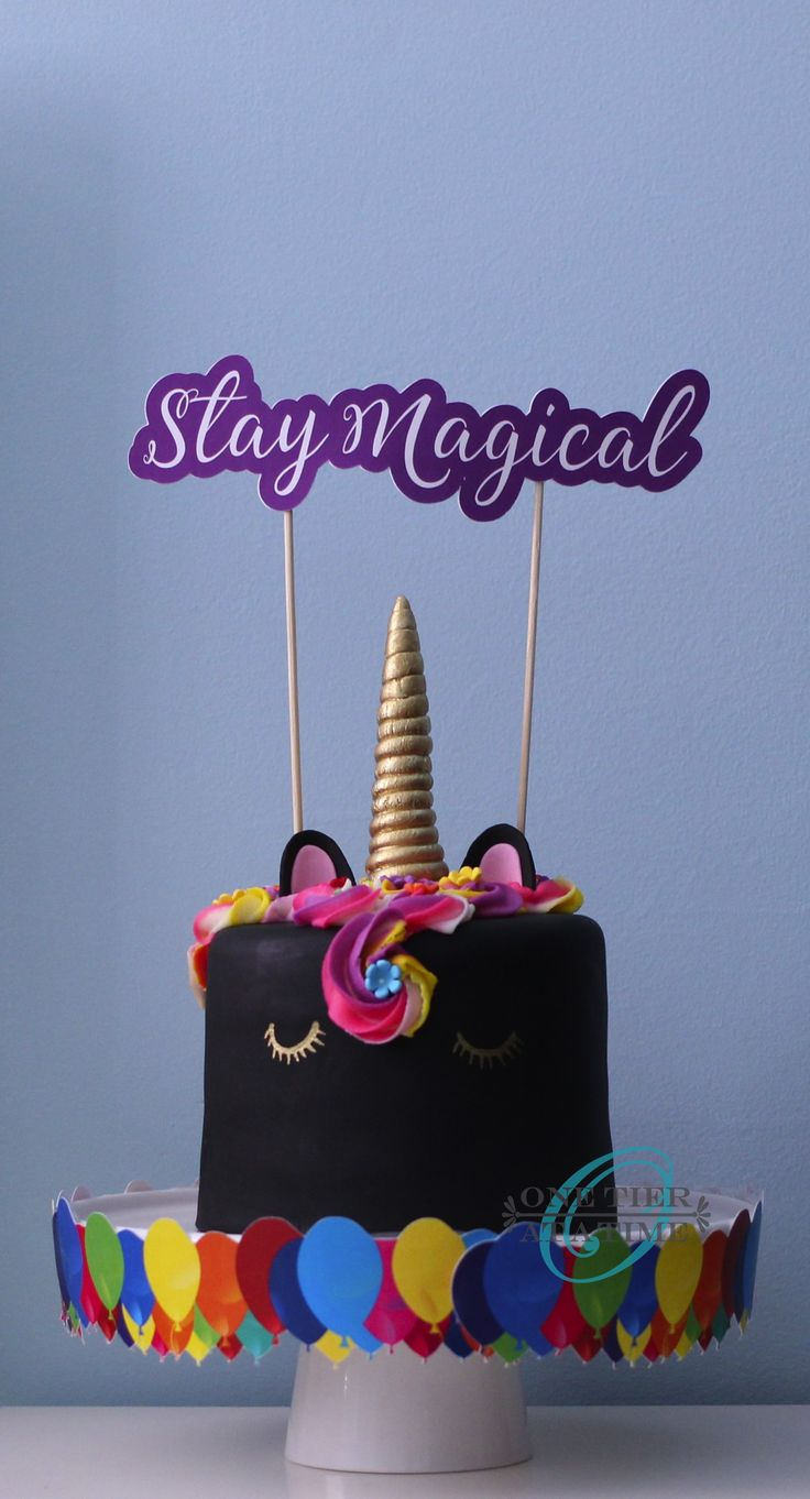 Black unicorn cake with rainbow buttercream