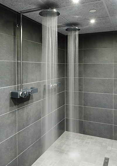 Hot Yoga Studios in Malmö, Sweden. Faucets: Water saving Oras Eterna rain showers with EcoLed Press Pad.