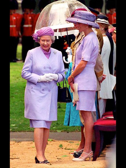 1994 - the Queen and Princess Diana at a London event, both wearing pretty lilac skirt suits with coordinating over-the-top toppers.