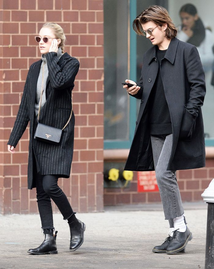 Stranger Things star Joe Keery just stepped out in coordinating skinny jeans with his actress girlfriend—see the chic photo.