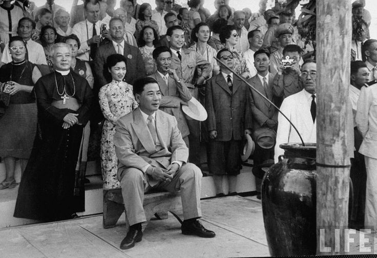 1957 - Vietnamese President Ngo Dinh Diem (seated) and his brother Bishop Ngo Dinh Thuc (L) attending a program held during New Year celebration in the central highlands. | by manhhai