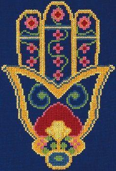 Hamsa hand embroidered in cross stitch