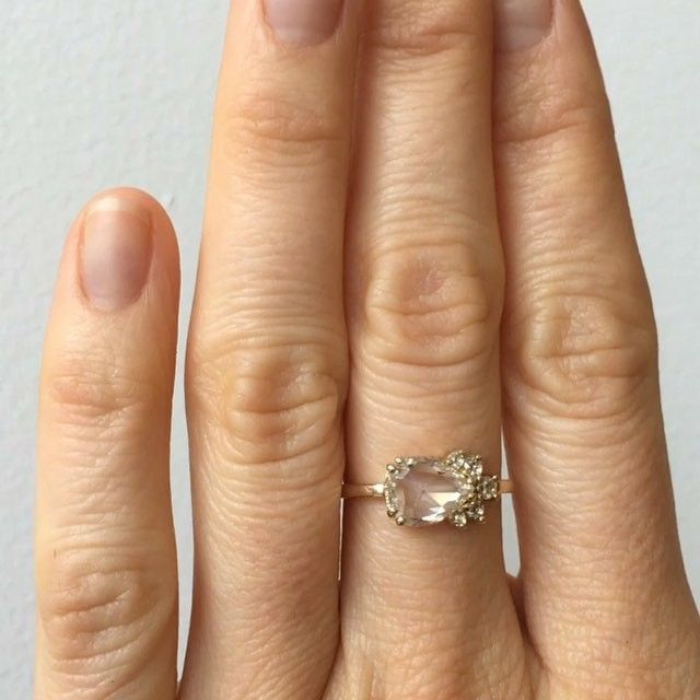 Custom rose cut diamond cluster ring with 1.03 carat pear shaped rose cut diamond flanked by round rose cut diamonds. Set in 14k yellow gold. If you're interested in creating a custom piece email custom@mociun.com #mociun #mociunjewelry #mociuncustom #diamonds