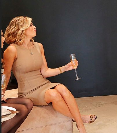 Perfectly poised and confident, Alexis Bellino - in the exact same dress and look I've seen my Hot Mom wear, same styling of her hair, and same high maintenance attitude.