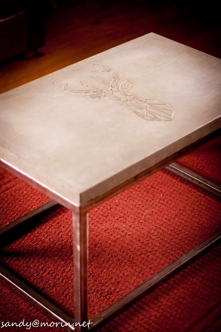 concrete cooffee table with a deer carve and wood effect